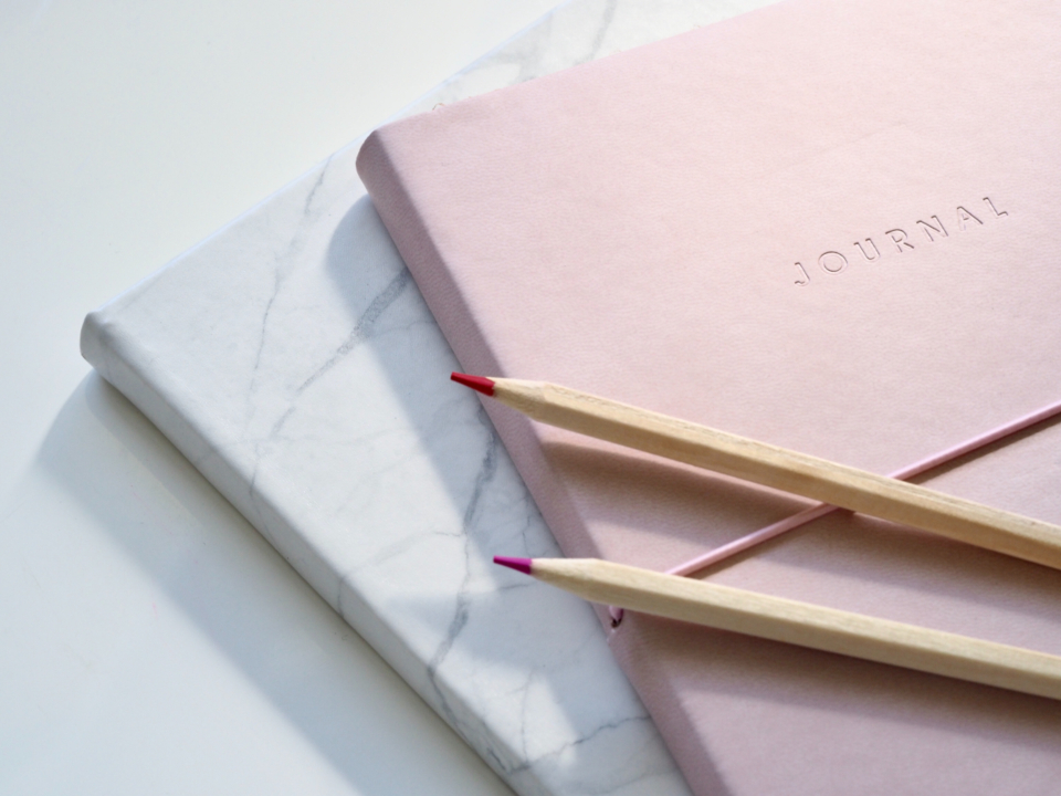 journal notepad pencils