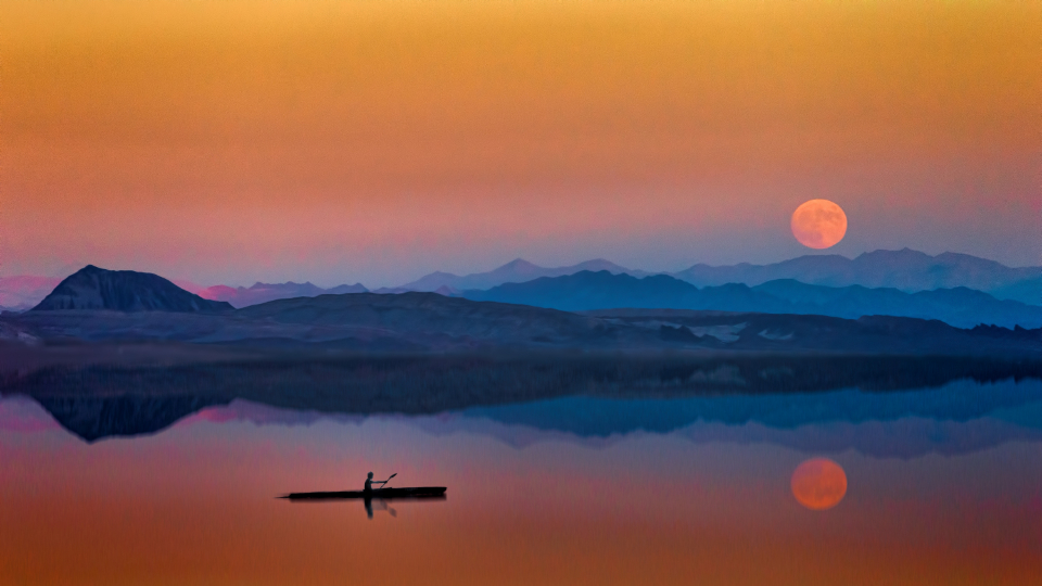 man canoe sunset