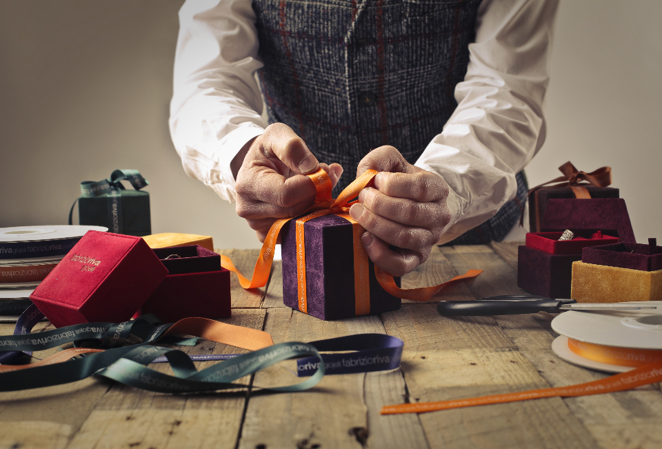 man wrapping gift
