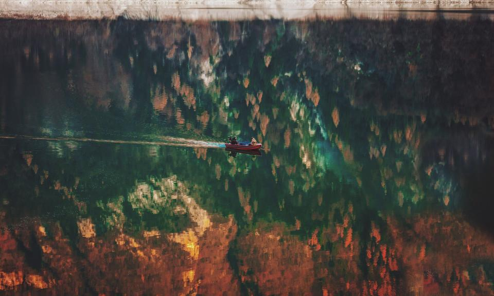 people boat reflection