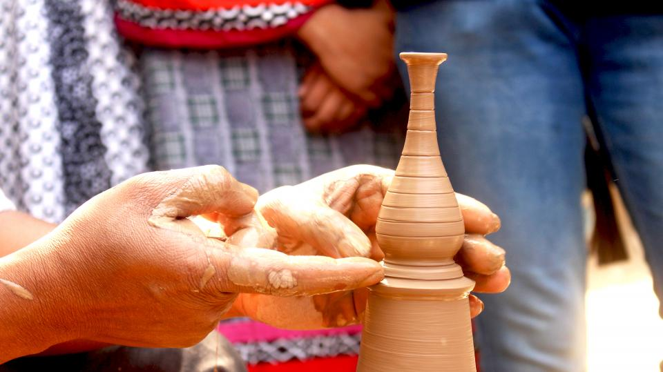people hand pottery