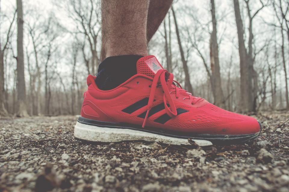 red sneakers running shoes