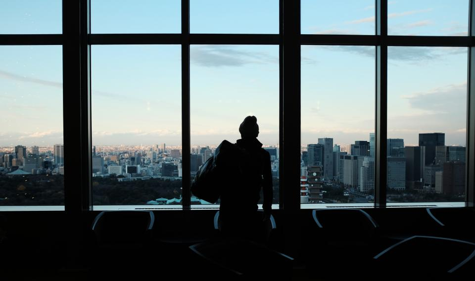 silhouette people building