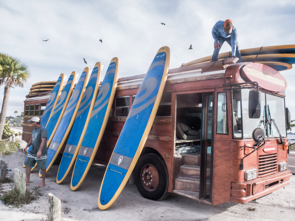 surfboard stacked bus