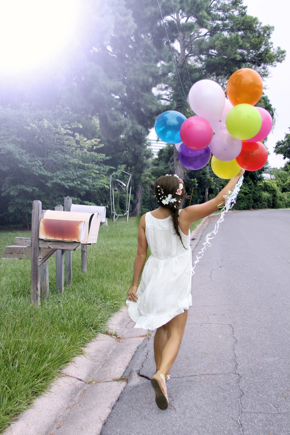 woman balloons person