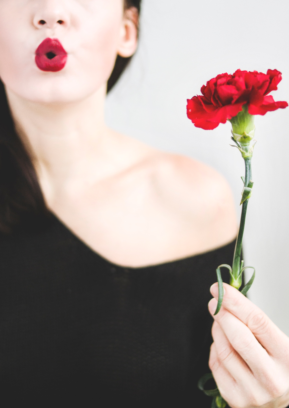 woman blowing kiss flower