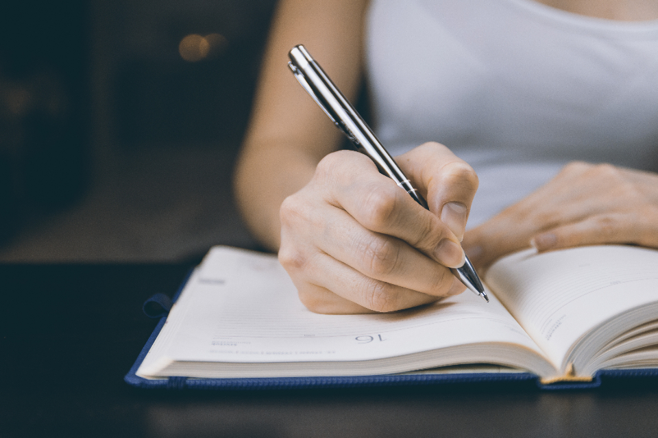 woman writing notepad